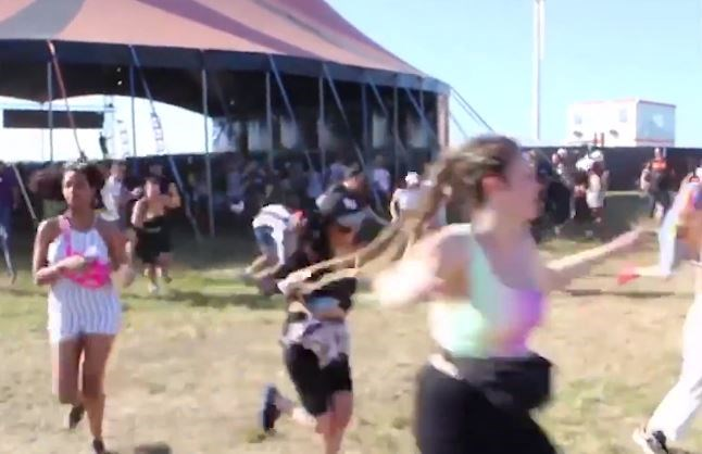 Chaos na afgelast festival: bezoekers rennen langs beveiliging en tappen zelf bier