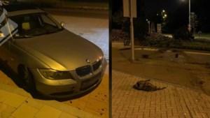 BMW zonder verlichting vliegt over rotonde na achtervolging