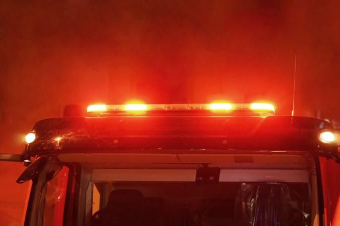 Bierglas onder band politieauto bij brand in Partij
