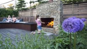 Ademnood in eigen huis door de houtkachel van de buren