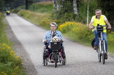 Op de ligfiets of scootmobiel, mensen met een beperking leggen aangepaste vierdaagse af in de Peel